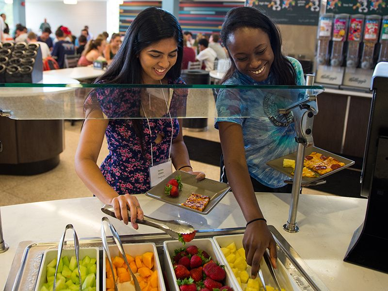 Students select from fresh fruit in the salad bar in Bruff Commons